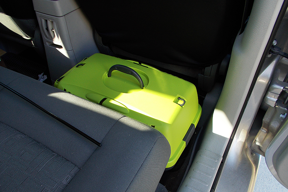 The safest option: Placing the carrier behind the passenger seat on the floor with the long side touching the seat.